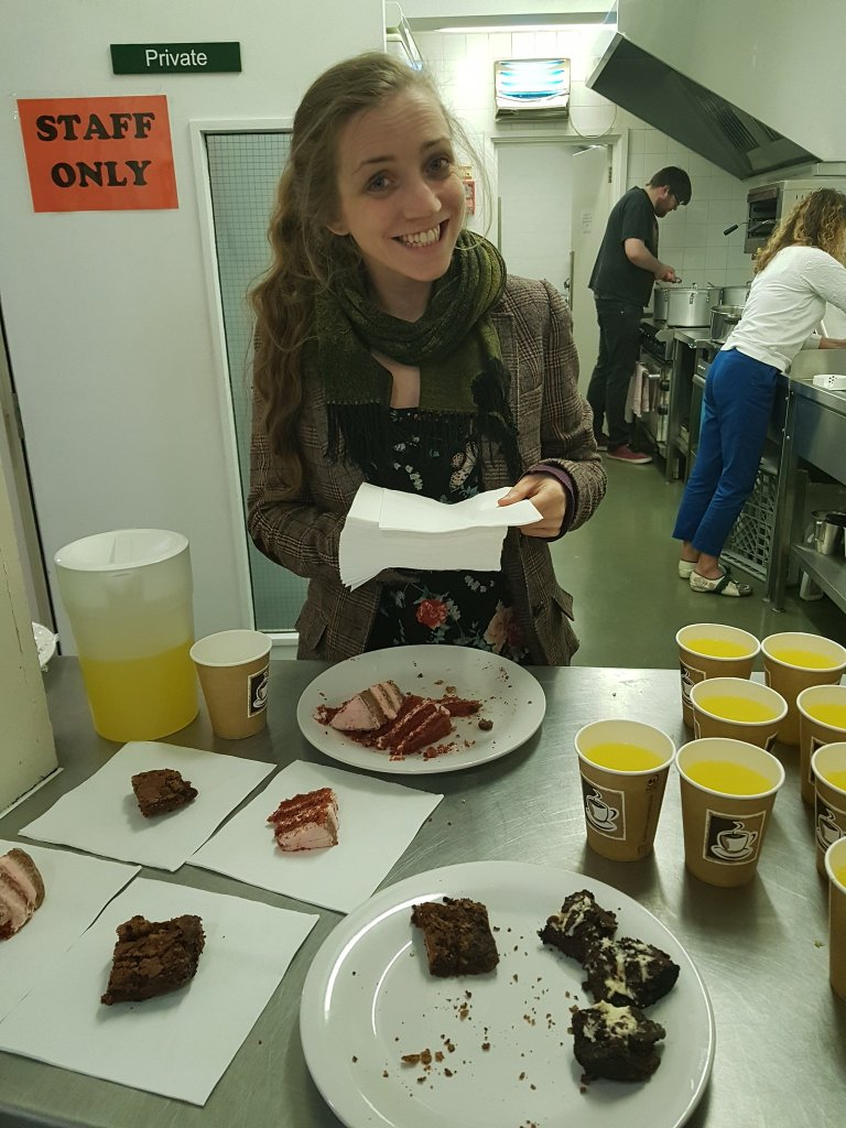 A young lady serving cake